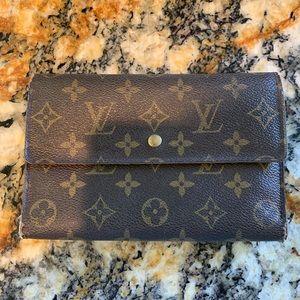 Louis Vuitton wallet. Worn on edges but it's cheap